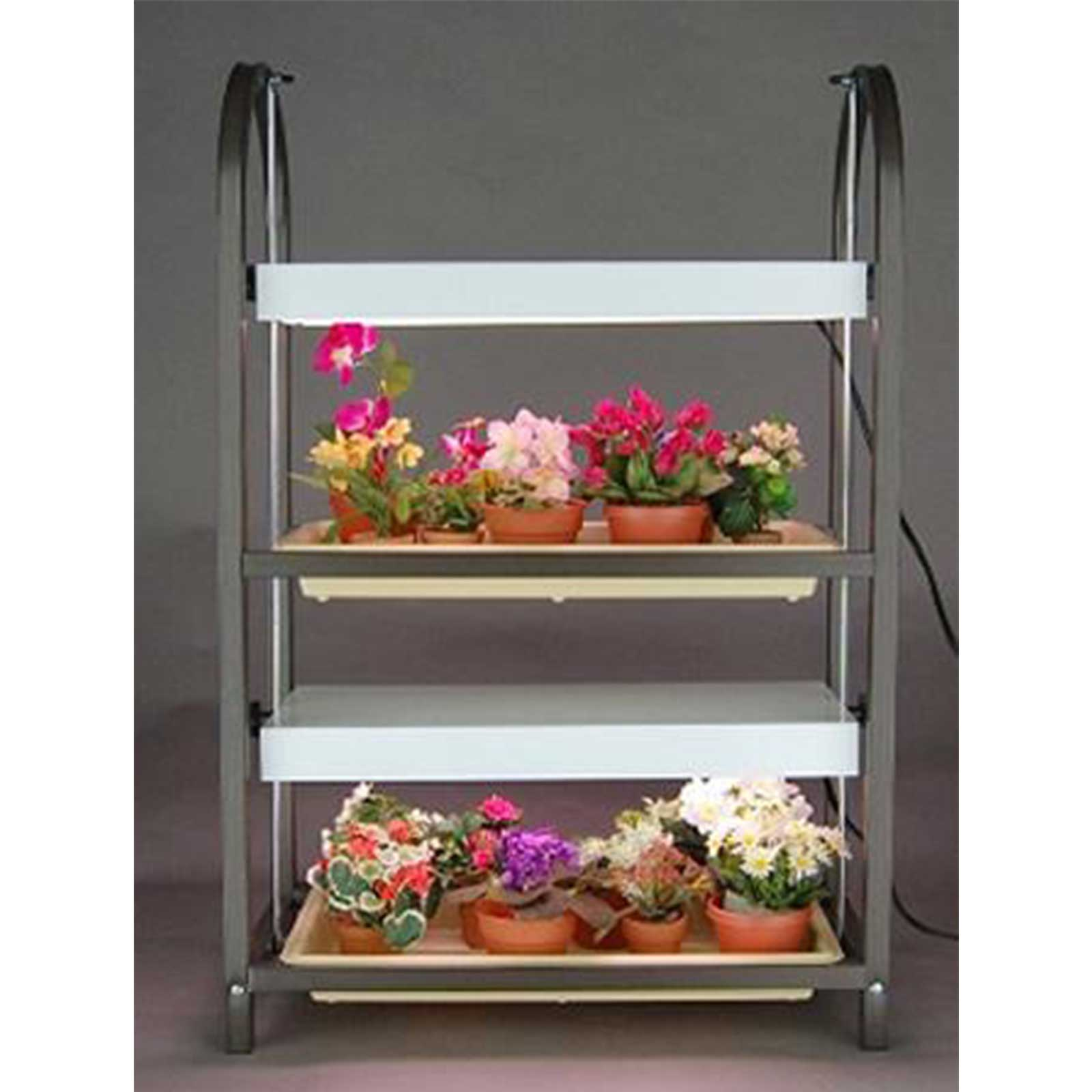 This wheatgrass growing stand will hold two trays of wheatgrass, microgreens, or whatever you are growing. It has two built in wide spectrum grow lights and two drip trays. Available in chrome and brown. Perfect for growing and rotation two trays of wheatgrass at a time.