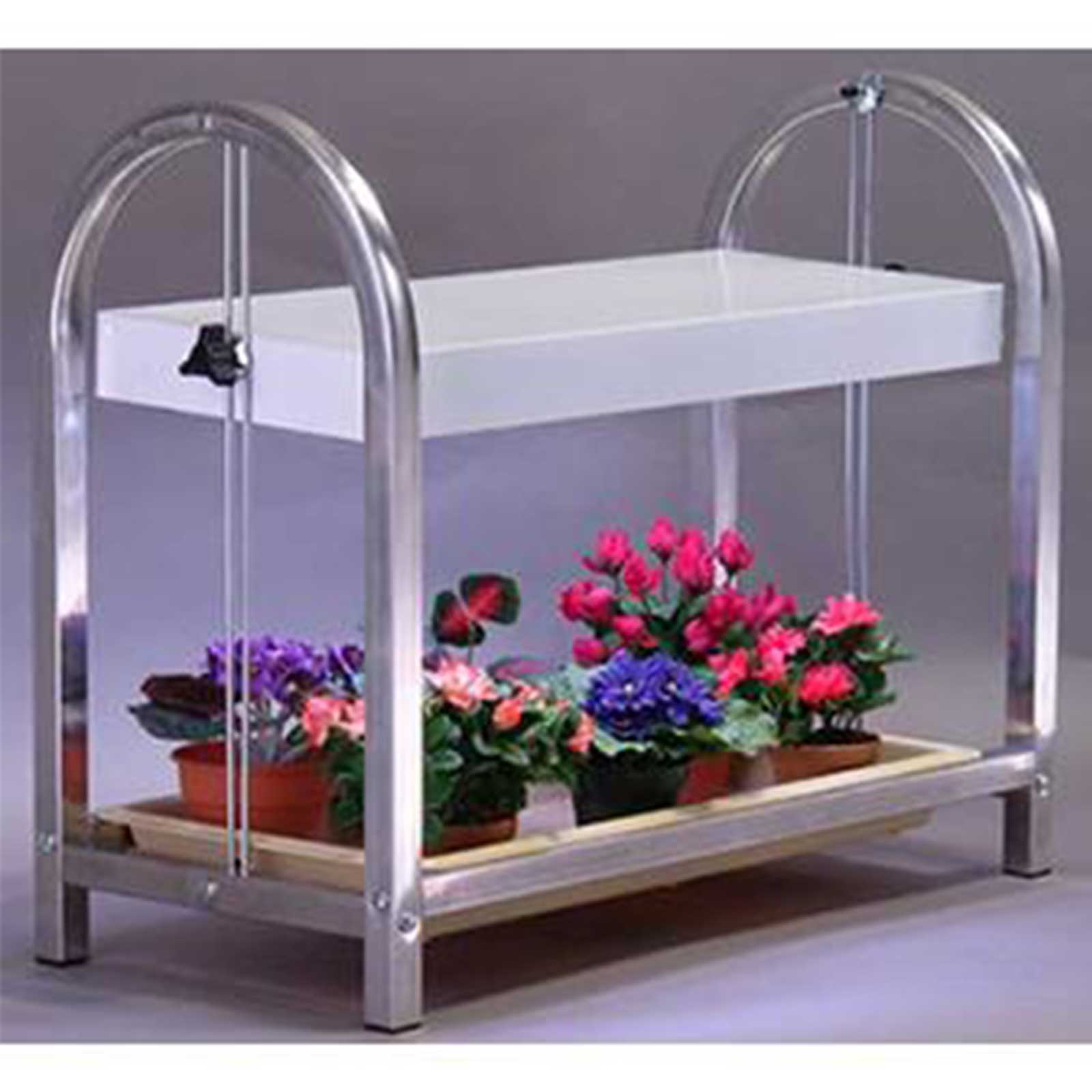 This plant growing rack will fit one tray of wheatgrass, barleygrass or microgreens at a time.  The grow stand has a built in growing light and a water drip tray. Comes with optional caster wheels. Available in chrome or brown color.